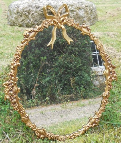 Ornate Gilt Metal Oval Wall Mirror
